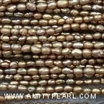 3603 freshwater rice pearl strand about 2mm champagne gold color.jpg