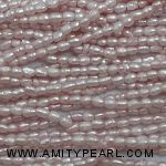 3608 freshwater rice pearl strand about 2mm light pink.jpg