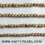 3167 side drilled pearl 4-4.5mm gold.jpg
