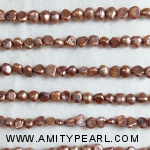 3182 side drilled pearl 3.5-4mm brown.jpg